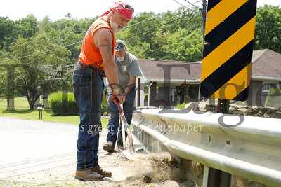 Doug Morrow and Tommy Sommers of the Butler County bridge work crew maintain the Muddy Creek Drive bridge over Muddy Creek near Route 8, south of Slippery Rock. Seb Foltz/Butler Eagle 07/25/19