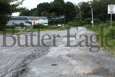 """MIDDLESEX Denny Rd. """"Middlesex Township officials announced earlier this month Denny Road will be completely paved by the end of this year. The unpaved section is at the Route 8 end."""" Photo by Samantha Beal."""