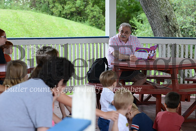Photo by J.W. Johnson Jr. Zelienople Manager Don Pepe reads to children and parents gathered Tuesday at the gazebo in Community Park. Pepe's story focused on community helpers and careers children may want to have as adults. The weekly storytime event is held at 11 a.m. each Tuesday and features special guest readers, as well as activities. No registration is required for the free event.