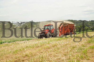 Garrett Miller runs one of the farms tractors to gather hay for baling. Seb Foltz/Butler Eagle