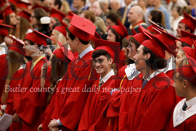 North Catholic graduates stand to participate in pre-ceremony mass Friday night during graduation. Seb Foltz/Butler Eagle