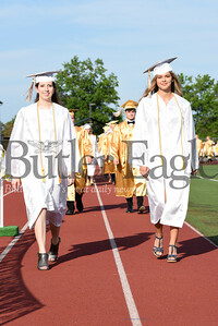 Harold Aughton/Butler Eagle: Butler seniors Faith Elizabeth Bajema (left) and Brenna Anne Anthony make their way to the 129th Annual Commencement at Art Bernardi Stadium.