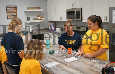 Photo by J.W. Johnson Jr. Polly Novotny and Mia Ola play a game in the life skills room at Mars High School.