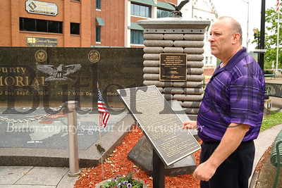 John Cyprian of the Veteran's Administration overlooks theWorld War II  memorial he helped create. Seb Foltz/Butler Eagle