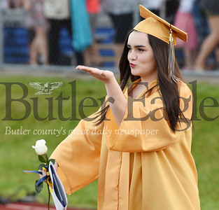 Harold Aughton/Butler Eagle: Knoch graduate Camryn Elise Lilley exits the ceremony blowing a kiss to her friends in tehe high school choir.
