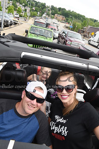 Harold Aughton/Butler Eagle: Patrick, Crystal and daughter, London, wait in line to joing the jeep parade Friday evening, June 7.