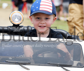 Harold Aughton/Butler Eagle: Kadyn Volz, 2, of Erie joined his day, Ryan, for a day of fun at the 9th Annual Bantam Jeep Festival, Saturday, June 8 at Cooper's Lake.