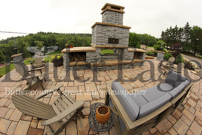 Backyard patio fireplace and pizza oven designed by Funyak Landscapes of Mars. Seb Foltz/Butler Eagle