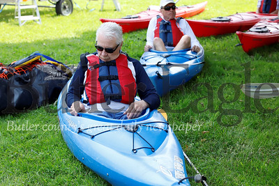 Tom Rudnicki (front) and Gene Pieszak test the fit of their kayaks and learn the basics of paddling on land prior to a senior center kayak outing at Morraine State Park. Seb Foltz/Butler Eagle