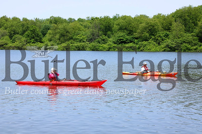 Slippery Rock senior center member Lynne Davis(left) paddles with Morraine State Park volunteer safety boater Bud Glenndenning. Seb Foltz/Butler Eagle