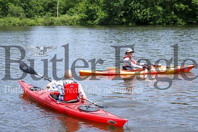 Gary Rettig (left) paddles out to join Morraine State Park volunteer safety boater Bud Glenndenning. Seb Foltz/Butler Eagle