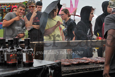 Hungry rib-fest goers stayed in good spirits Saturday handling long lines and a light rain to enjoy fresh ribs from a host of booths at the first Butler Rib & Music Fest.Seb Foltz/ Butler Eagle