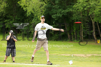 Course designer and Cranbrery Township Pittsburgh Flying Disc course promoter Doug Cloutier throws an inaugural disc at the official grand opening of the disc golf course in North Boundary Park. While pins have been up since last summer, Cranberry township officials and volunteers have recently put finishing touches on the course, including tee boxes and course signage. Seb Foltz/ Butler Eagle