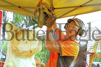 Butler chainsaw artist Damian Skal works on a bear carving at Whispering Pines Saturday. Seb Foltz/ Butler Eagle