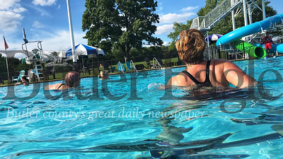 Kathy Wendling, who taught water aerobics at the Butler YMCA for 18 years, leads the group during water aerobics at Alameda Waterpark. Photo by Gabriella Canales.