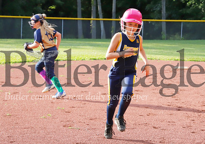 Freeport 10u softball's Leah Clark rounds third base on her way to score. Her Sister Lauren earned an RBI on the play. Seb Foltz/Butler Eagle