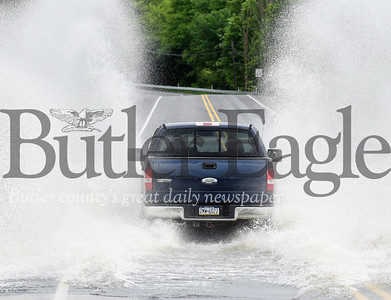 Harold Aughton/Butler Eagle: Sections of route 38 were closed Tuesday afternoon due to flooding...