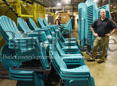 Harold Aughton/Butler Eagle: Daniel Stainer, director of marketing for Adams USA, stands in front of a set of Teal Adirondack chairs, the most popular color the company manufacturers.