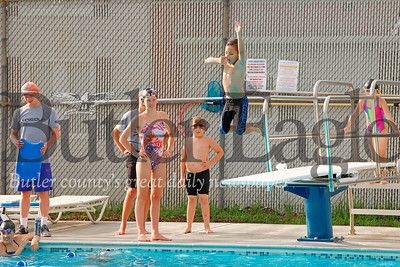Austin Keally enjoys a diving board session after swim practice with the Zeienople Area Swim Club. Swimmers enjoyed a break in the rain with some evening sunshine at the newly remodeled EDCO Park Pool in Evans City Wednesday. Seb Foltz/Butler Eagle