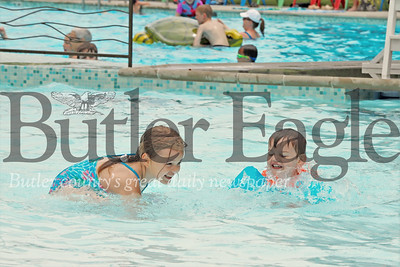 Owen and Mackenzie White splash around in the newly renovated Zelienople Community Pool. The pool opened for the season over the weekend. Seb Foltz/Butler Eagle