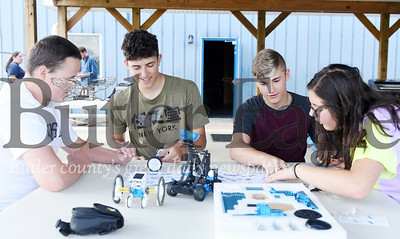 Harold Aughton/Butler Ealge: Teenages at Camp Apple, (left - right) Ryan Rumbaugh, Anthony Panichelle, Brayden Young and Isabella Panichelle, work together to assemble a robot, Tuesday, June 26.