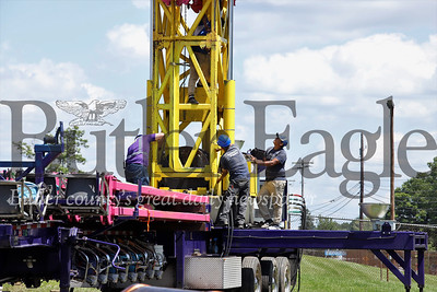 Workers prepare the Vertigo ride for the Big Butler Fair set to open later this week. Seb Foltz/Butler Eagle