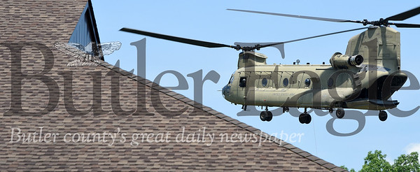 """Harold Aughton/Butler Eagle: A CH-47 Chinook hovers above BC3's emergency training facility during the Pennsylvania Helicopter Aquatic Rescue Team's  """"Category 5 Hurricane Jessica"""" training mission on BC3's main campus, Thursday, June 27."""