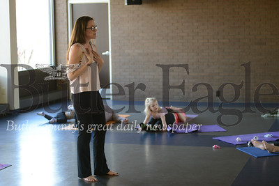 Rachel Dzagulones started leading youth yoga classes at the Butler YMCA last fall after seeing the positive impact on her and her children's lives. Dzagulones is pictured here leading the class Thursday morning.