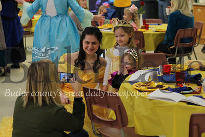 Mars High School Principal Lindsay Rosswog takes a picture of her daughters Quinn, 4, and Payton, 2, with Mars High Schooler Mia Manuppelli, starring as Belle in the high school's production of Beauty and the Beast. photo by Caleb Harshberger