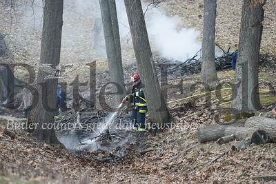 Photo by J.W. Johnson Jr. Crews from the Adams Area Fire District extinguish a brush fire Tuesday in Mars.