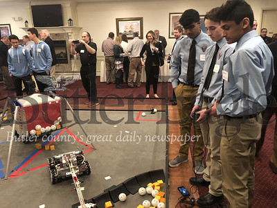 Photo by J.W. Johnson Jr. Students show off their robot creations Thursday during the Mars New Year Blast-Off Dinner.