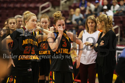 North Catholic players react after loss.