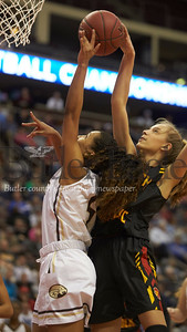 North Catholic's #21 Kylee Lewandowski blocks shot by Becahi's #5 Briana Barnard in the first half.