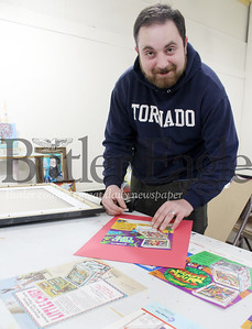Stephen Haley, gallery manager of the Butler Art Center, prepares for this weekend's pinball show, featuring vintage pinball machines from the 70's.