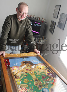 Pat Gallagher, 64, of Butler plays a Gottlieb's Sluggin Champ pinball machine manufactured in 1956.