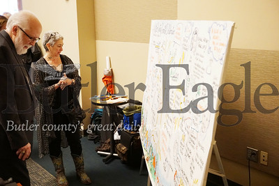Photo by J.W. Johnson Jr. Artist Leah Silverman shows off a drawing based on speakers at Friday's Community Development Corporation of Butler County annual meeting at the Regional Learning Alliance in Cranberry Township.