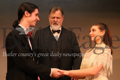 "Taryn Pfeifer (right), John C.R. Silbert (center) and Luke Pfeifer(right) rehearse the wedding scene between their characters Emily Web and George Gibbs in the Butler Little Theatre's production of ""Our Town."" Seb Foltz/Butler Eagle"