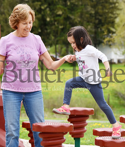 Harold Aughton/Butler Eagle: Lucia Palamara, 3, of Forward Twp. gets a helping hand from her grandmother, Jan Palamara Thursday morning at the Harcrest Park in Penn Twp.