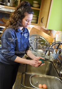 Harold Aughton/Butler Eagle: Rachel Forth, a senior parks and resources major at Slippery Rock University, cleans the eggs she harvested at the Macoskey Center.