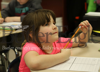 McQuistion Elementary first grader Kaylen Parker brainstorms Mother's Day letter ideas with teacher Rene Ruffner (Not Pictured). Seb Foltz/Butler Eagle