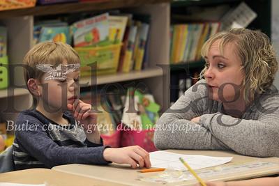 McQuistion Elementary first grader Dylan Bellis ponders Mother's Day letter ideas with teacher Rene Ruffner. Seb Foltz/Butler Eagle