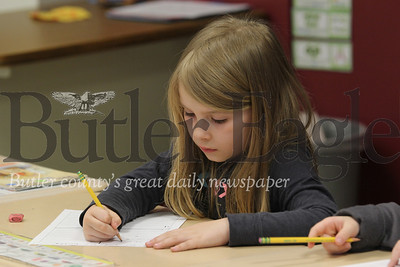McQuistion Elementary first grader Emily Mcandles works on her Mother's Day letter. Seb Foltz/Butler Eagle
