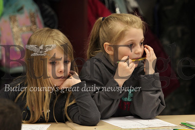 McQuistion Elementary first grader Emily Mcandles(left) and Harlow Jensen brainstorm ideas for their Mother's Day letters. Seb Foltz/Butler Eagle