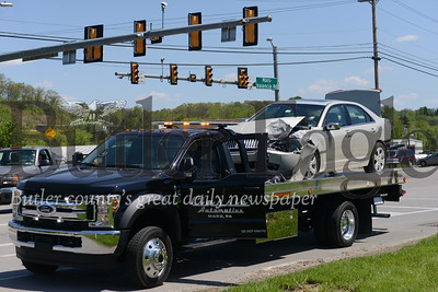 photo by Caleb Harshberger. At least one motorist was injured in a four vehicle crash at the intersection of Route 228 and Mars-Valencia Road Monday.