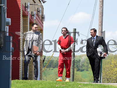 Butler Eagle Staff Photo: State Troopers, Max DeLuca, and Robert Rottman escort Alec Miller into the Magistrates office in Chicora, Tuesday, May 7.