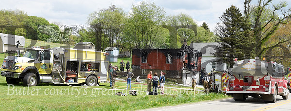 Harold Aughton/Butler Eagle:  A storage building at the Olcus residents along Rt. 268 near East Brady was destroyed by fire Tuesday, May 7. Firefighters and emergency personnel from East Brady, Chicora, Petrolia, West and East Franklin, as well as, Sugarcreek Ambulance responded to the fire.