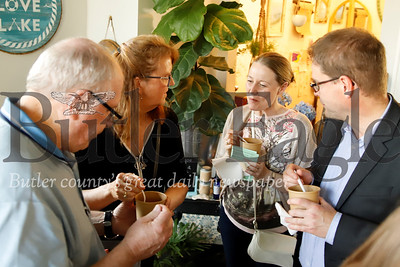 Mayor Johannes Bruns (right), Nancy Krug of Mulhausen, Germany chat with Saxonburg mayor William Gillespie and his wife Sue Gillespie at Batch restaurant in Saxonburg. Seb Foltz/Butler Eagle