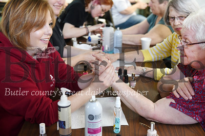 Harold Aughton/Butler Eagle: Ellen Mahler, a student at the Butler Beauty School, massages the hands of Jakie Fedorek, 80, of Chicora, May 9 at the Chicora Senior Center.