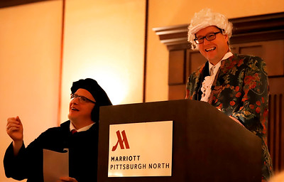 German mayor Johannes Bruns(right) and Frank Moeller of Mulhausen, Germany -- Saxonburg's sister city -- tell the story of their home town's history to guests at the annual Butler County Tourism Dinner. Seb Foltz/Butler Eagle