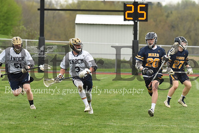 Mars' Nick Spotti pushes past Matt Goodlin of Knoch. Seb Foltz/Butler Eagle